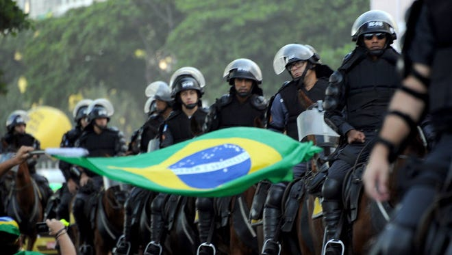 Police participate in a demonstration in Rio de Janeiro on April 17, 2016.