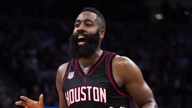 Rockets guard James Harden (13) reacts after a three-point basket against the Kings.