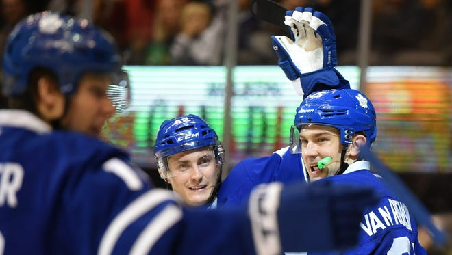Maple Leafs forward James van Riemsdyk (25) celebrates his second-period goal against the Capitals with linemates Tyler Bozak (42) and Mitch Marner (16).