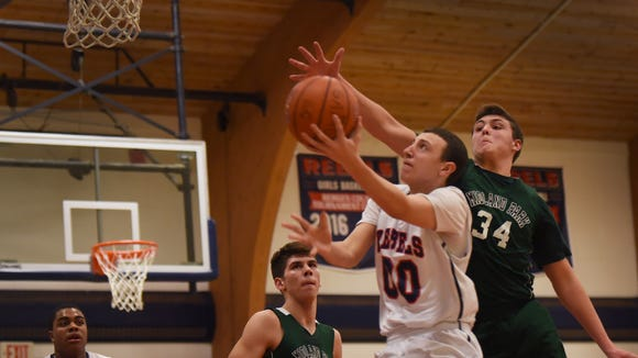 Nick Eiler (00) and Saddle River Day clinched the NJIC Patriot Division boys basketball title with a win Monday over Emerson.