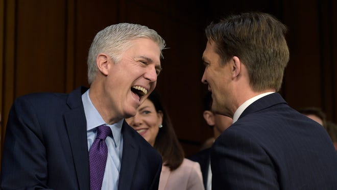 Neil Gorsuch shares a laugh with Sen. Ben Sasse, R-Neb., as he arrives on Capitol Hill on March 21, 2017, for his confirmation hearing.