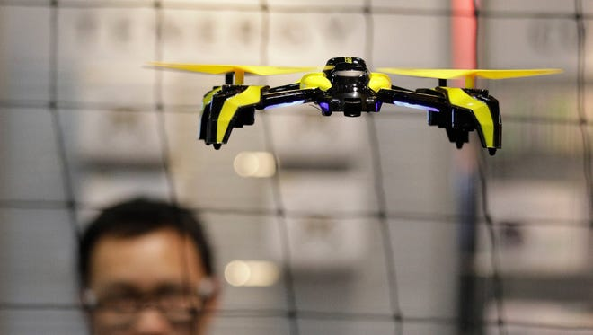 The world's largest manufacturer of civilian drones is proposing that drones be required to continually transmit identification information to help government security agencies and law enforcement figure out which might belong to rogue operators.