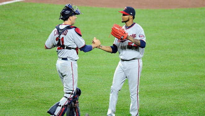 Twins starting pitcher Ervin Santana celebrates with catcher Jason Castro after pitching a shutout against the Orioles at Oriole Park at Camden Yards in Baltimore.