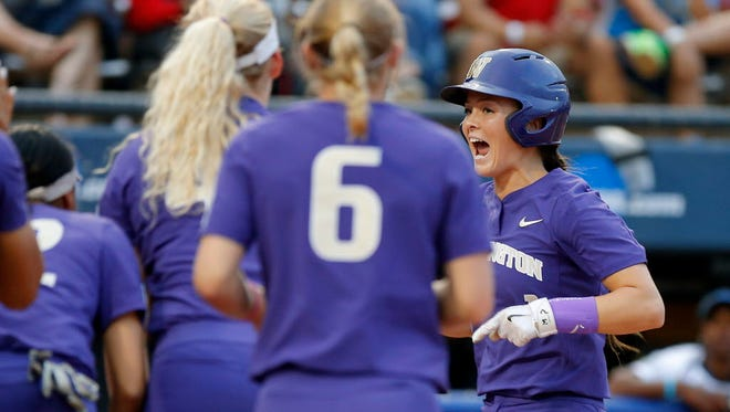 Washington's Ali Aguilar, right, celebrates as she crosses home plate after hitting a home run against UCLA in the sixth inning.
