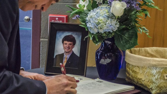 A visitor signs the condolence book during the funeral service of Otto Warmbier in Wyoming, Ohio, on June 22. Otto Warmbier died on June 19 in his hometown of Wyoming, a suburb of Cincinnati, a few days after his return from North Korea.