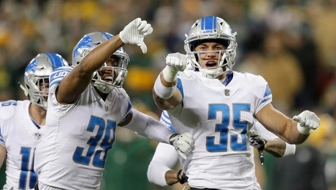 Detroit Lions strong safety Miles Killebrew (35) celebrates after making a big hit on a kick off return by the Green Bay Packers Monday, November 6, 2017, at Lambeau Field in Green Bay, Wis.