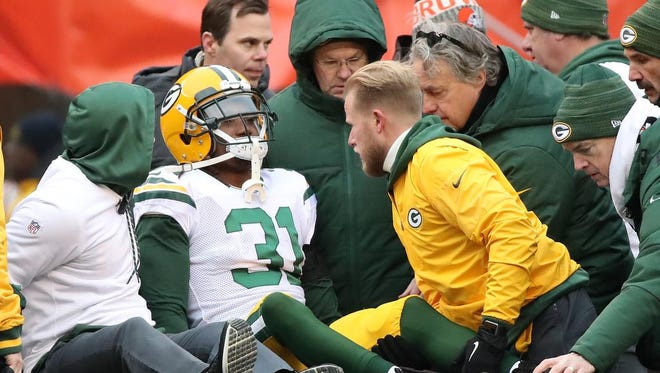 Green Bay Packers cornerback Davon House (31) is taken off the field with an injury against the Cleveland Browns on Dec. 10, 2017 at FirstEnergy Stadium in Cleveland