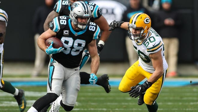 Carolina Panthers tight end Greg Olsen (88) runs for yards after the catch chased by Green Bay Packers inside linebacker Blake Martinez (50) during the second quarter at Bank of America Stadium.