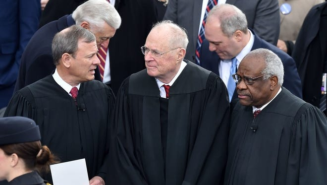 Chief Justice John Roberts, Justice Anthony Kennedy and Justice Clarence Thomas, U.S. Capitol, January 20, 2017.