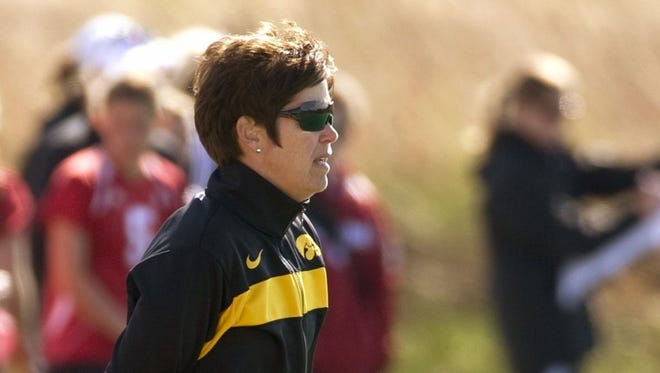 In this photo provided by the University of Iowa athletics department, women's field hockey coach Tracey Griesbaum watches the team from the sidelines. Griesbaum, who led the Hawkeyes to success during a 14-year tenure, says she was fired after a group of former players falsely claimed that she mistreated them and that she did nothing to warrant being relieved from her post.