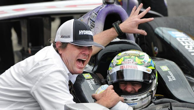 Jimmy Vasser celebrates with driver Tony Kanaan in Victory Circle after winning his first Indianapolis 500 race at the Indianapolis Motor Speedway, May 26 2013.