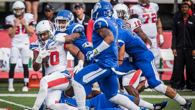 Ball State's Dylan Curry fights past Indiana State's defense during their game against Indiana State at Scheumann Stadium Saturday.