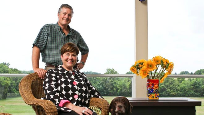 Loreee and John Holland -- who used to live in the Highlands -- now live in Fisherville in a house on eight acres. They love sitting out on their covered back deck. June 20, 2014 cjdeck2014