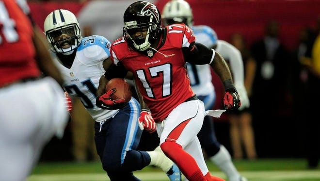 Falcons wide receiver Devin Hester speeds past Titans strong safety Bernard Pollard for a touchdown in the first quarter.