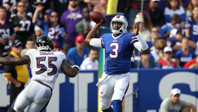 EJ Manuel steps up to throw under pressure by Ravens Terrell Suggs. Mauel threw for 167 yards and a touchdown.
