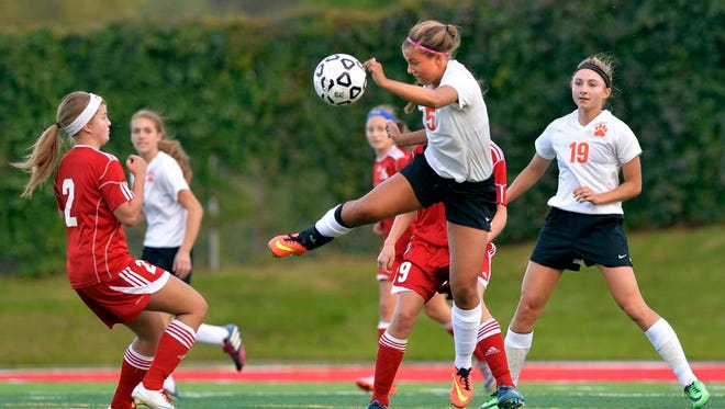 St. Cloud Tech's Mara Weaver (5) takes to the air for a kick in the first half Tuesday evening, Sept. 17 at Husky Stadium.