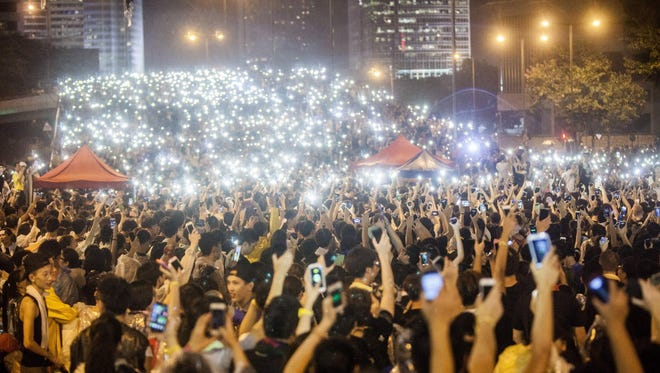 Pro-democracy demonstrators gather for the third night in Hong Kong.