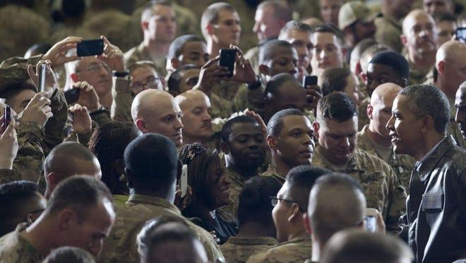 President Obama surprises U.S. troops in Kabul, Afghanistan, on Sunday.