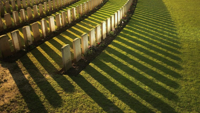 The setting sun creates long shadows in front of the graves at Sanctuary Wood Military Cemetery on August 1 in Ypres, Belgium. August 4 marks the 100th anniversary of Great Britain declaring war on Germany.