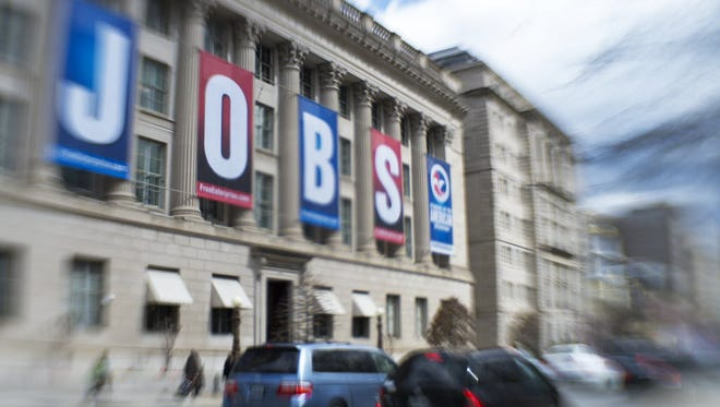 Traffic travels past the Chamber of Commerce building in Washington, DC. (Paul J. Richards, AFP/Getty Images)