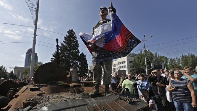 A pro-Russia rebel delivers a speech in  eastern Ukraine on Sunday.