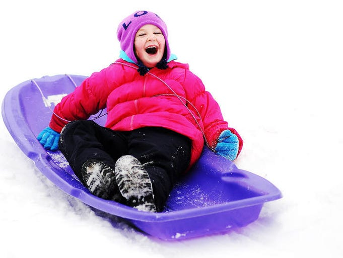 Desiree Hinsch, 5, rides down the hill backwards at Tuthill Park after the Candy Cane Hunt, which was supposed to be held from 10:45 a.m. to 11:45 a.m., appeared to be cancelled in Sioux Falls on Saturday, Jan. 11, 2014.