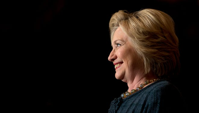 Democratic presidential candidate Hillary Clinton smiles while speaking at a rally at the Orpheum Theatre, Tuesday, Jan. 5, 2016, in Sioux City, Iowa.