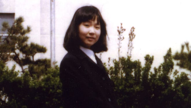 In this photo taken in 1977 and released by National Association for the Rescue of Japanese Kidnapped by North Korea, Megumi Yokota, 13, stands in front of Yorii Junior High School in Niigata, northwestern Japan, before her abduction by North Korean agents.