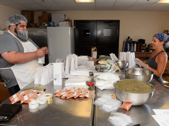 Steve Dogiakos, left, and Katie Eney started Choteau Spice Co. three months ago in Choteau. They grind and mix five types of seasonings every month in a rented commercial kitchen.