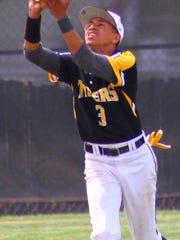 Alamogordo senior center fielder Wellington Balsley catches a fly ball.