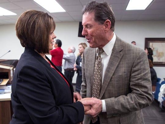 Nueces County Commissioner Carolyn Vaughn (left) talks