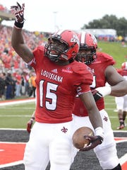 Elijah McGuire celebrates a touchdown against Southern at Cajun Field in Lafayette.
