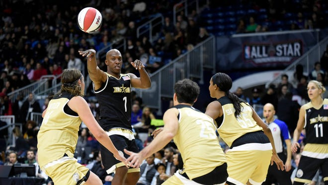 Feb 12, 2016; Toronto, Ontario, Canada; USA player Chauncey Billups (1) passes the ball during the All-Star celebrity basketball game at Ricoh Coliseum.