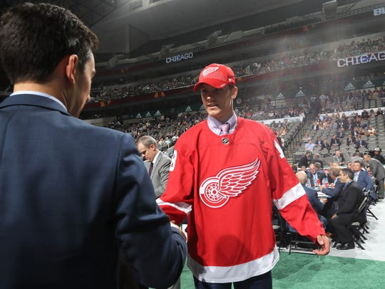 Alec Regula reacts after being selected 67th overall