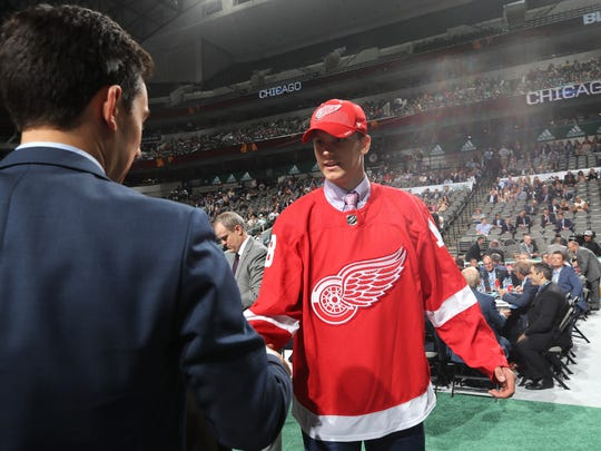Alec Regula reacts after being selected 67th overall by the Detroit Red Wings during the 2018 NHL draft at American Airlines Center on June 23, 2018.