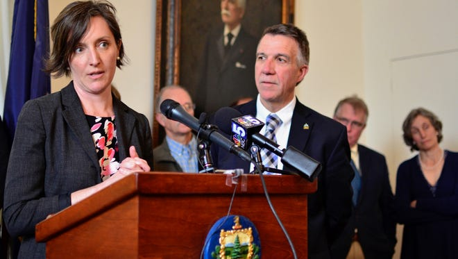 Nicole Mace, executive director of the Vermont School Boards Association, appears with Gov. Phil Scott in support of a statewide teacher health insurance plan on April 25, 2017.