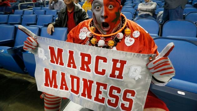Jon Peters, of Ohio, gets in the spirit of March Madness before a second-round game of the NCAA college basketball tournament between Ohio State and Dayton in Buffalo, N.Y., Thursday, March 20, 2014.  (AP Photo/The Buffalo News, Robert Kirkham) TV OUT; MAGS OUT; MANDATORY CREDIT; BATAVIA DAILY NEWS OUT; DUNKIRK OBSERVER OUT; JAMESTOWN POST-JOURNAL OUT; LOCKPORT UNION-SUN JOURNAL OUT; NIAGARA GAZETTE OUT; OLEAN TIMES-HERALD OUT; SALAMANCA PRESS OUT; TONAWANDA NEWS OUT ORG XMIT: NYBUE107
