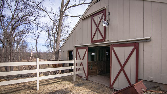 This property comes with equestrian paddocks and a five-stall barn with a tack room.