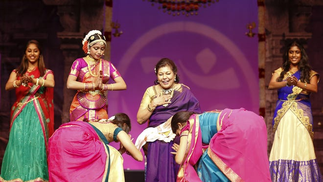 Asha Gopal sits on the stage at the Chandler Center for the Arts while her students honor her on August 13, 2016. Asha Gopal, founder/director of Arathi School of Dance, will enter the Guinness World Records with her 200th student graduation in a special type of Indian classical dance.