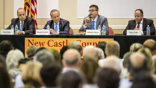 Candidates for New Castle County executive (from left) Mark Blake, Thomas P. Gordon, Matt Meyer and Barry Nahe speak at a forum in Hockessin in August. An email from a police organization is causing a controversy in the primary election.