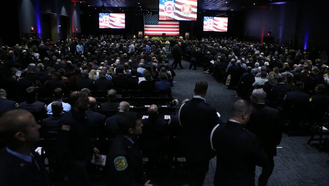 Attendees, most emergency responders in uniform representing departments from across the country, fill the Chase Center on the Riverfront before the memorial service for Wilmington firefighters Christopher Leach and Jerry Fickes Saturday.