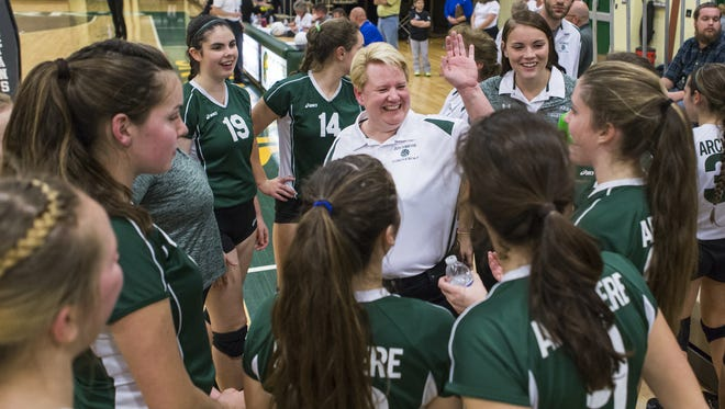Archmere girls volleyball coach Mary Pat Kwoka talks with her team during a timeout in a DIAA tournament semifinal match against Padua last season.