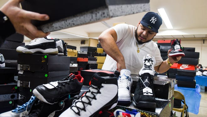Izzy Martinez, owner of Crazy Kix consignment shoe store in Allentown, Pa., sets up his stand as Sneakerheads of Pennsylvania held their first sneaker convention at the Lebanon Valley Expo Center on Sunday, Feb. 19, 2017.