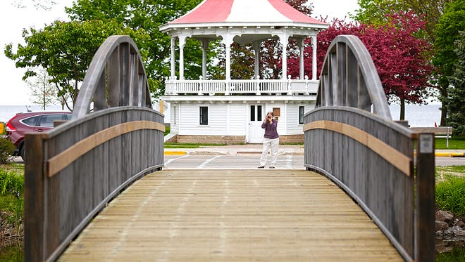Maher Saiyed of Fond du Lac takes a photo of the new walking bridge at Lakeside Park.