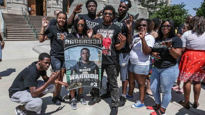 Jalen Frazier, center right, and Christa Frazier, far right, the brother and mother of Warren Central student-athlete Dijon Anderson who lost his life to gun violence stands with Warren Central classmates and a memorial banner during the City-Wide End the Violence Rally on Saturday June 3, 2017. Attendees marched from the Indiana Statehouse to Monument Circle in Indianapolis,