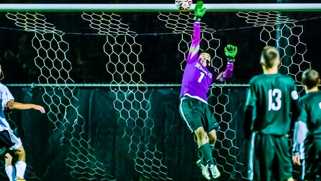 Williamston goalie Jake Iannarelli deflects a Frankenmuth shot on goal from a free kick early in the 2nd half with Williamston leading 2-1.