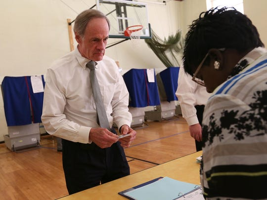 Sen. Tom Carper checks to vote at P.S. duPont Middle School on Tuesday morning