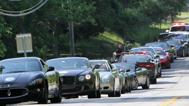 New York state police with assistance from Putnam County Sheriffs pulled over several Maseratis that were traveling together northbound on Route 22 in Patterson Saturday morning May 28, 2016.