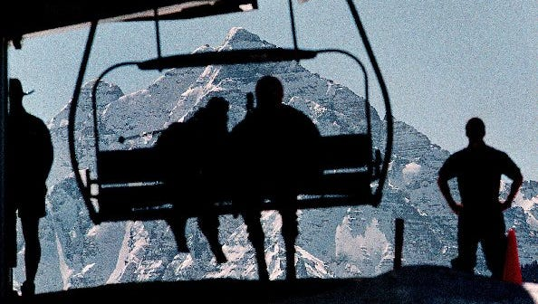Skiers unload from the Summit Express lift at Aspen's Buttermilk Mountain.