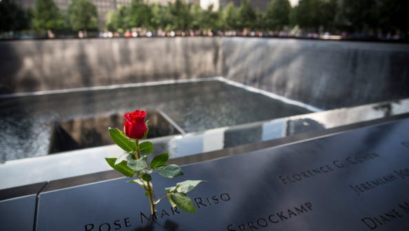 NEW YORK, NY - SEPTEMBER 10:  A rose is left in rememberance of Rose Mary Riso, a victim of the September 11th terrorist attacks, at the National September 11 Memorial on September 10, 2014 in New York City. Tomorrow the country will pause to reflect and remember on the 13th anniversary of the attacks.  (Photo by Andrew Burton/Getty Images)